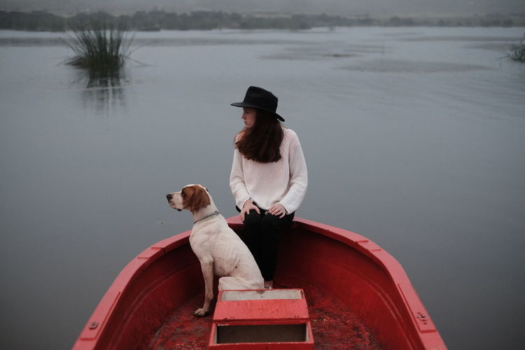 Boat missions with the dog in tow. Boat Boho Cold Day Dog Girl Girl And Dog Lake Misty Mode Of Transport Moored Nautical Vessel Outdoors Pet Sitting Transportation Water Wildlife