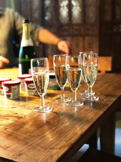 After hour Drink Refreshment Food And Drink Alcohol Table Glass Bottle Household Equipment Indoors  No People Focus On Foreground Container Wine Wineglass Transparent Still Life Freshness Close-up Glass - Material Drinking Glass