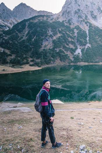 Full length of man standing near a lake