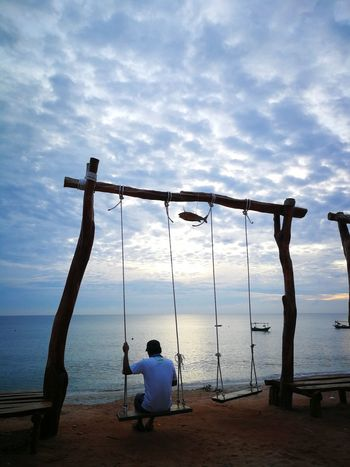 Water One Person Cloud - Sky Beach Sky Rear View People Full Length Sea One Man Only Sitting Adult Only Men Day Outdoors Lifestyles Adults Only Horizon Over Water Men Nature Kuala Terengganu Malaysia Swing By The Sea An Eye For Travel