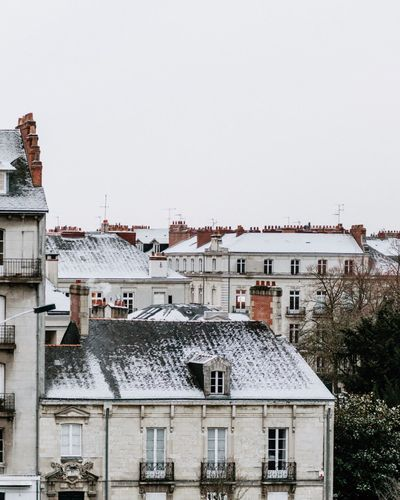 Winter finally shows his white coat! France Building Exterior Architecture Built Structure House Residential Building Outdoors Winter No People Town Roof Snow City Cityscape Tiled Roof  Day Sky