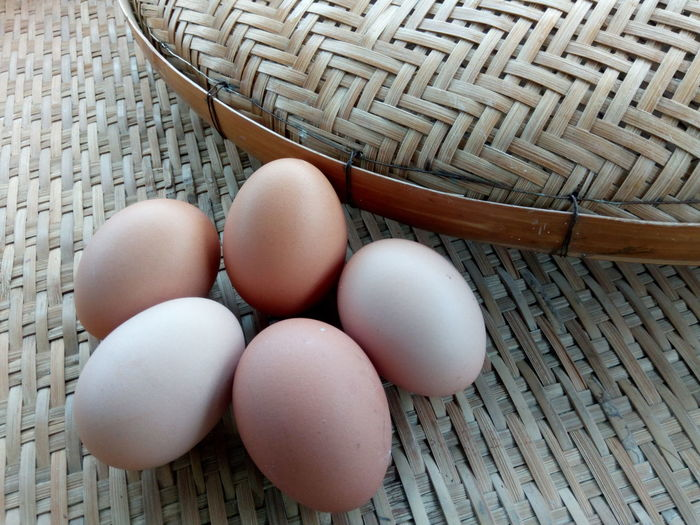 Fresh eggs on the wooden threshing basket in the kitchen Arrangement Decoration Design Kitchen Bamboo Basket Threshing Basket Protien Brown Wooden Food Fresh EyeEm Selects Egg High Angle View Food Egg Carton Pattern Healthy Eating Easter Indoors  Day No People Close-up Freshness