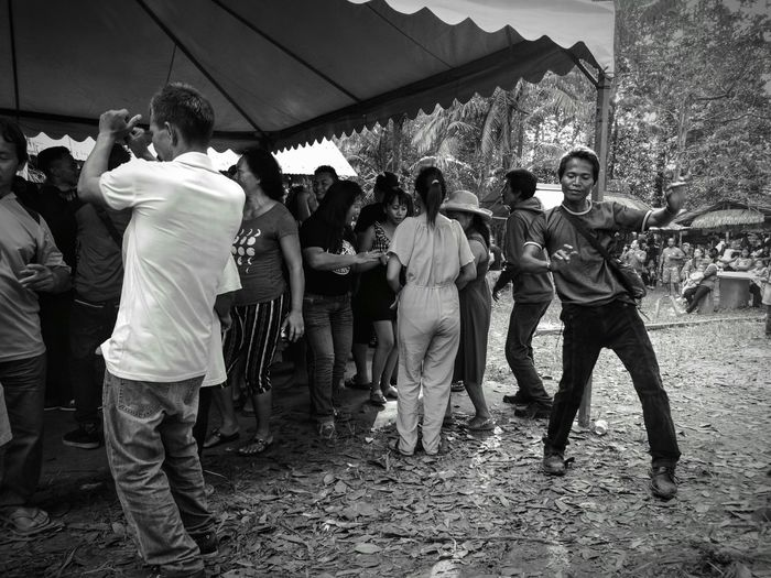 Dancing like nobody's watching. HuaweiP9Photography Monochrome Photography People Watching People Together People Around You Peopledancing Festive Season Festive Mood Gawaidayak2017 Borneo Fun Happy People Places I've Been Day2 Men And Women Village Life Village Photography Drinking Beer Drunk People Drunk Photography Sarawak ExoticFood Real People