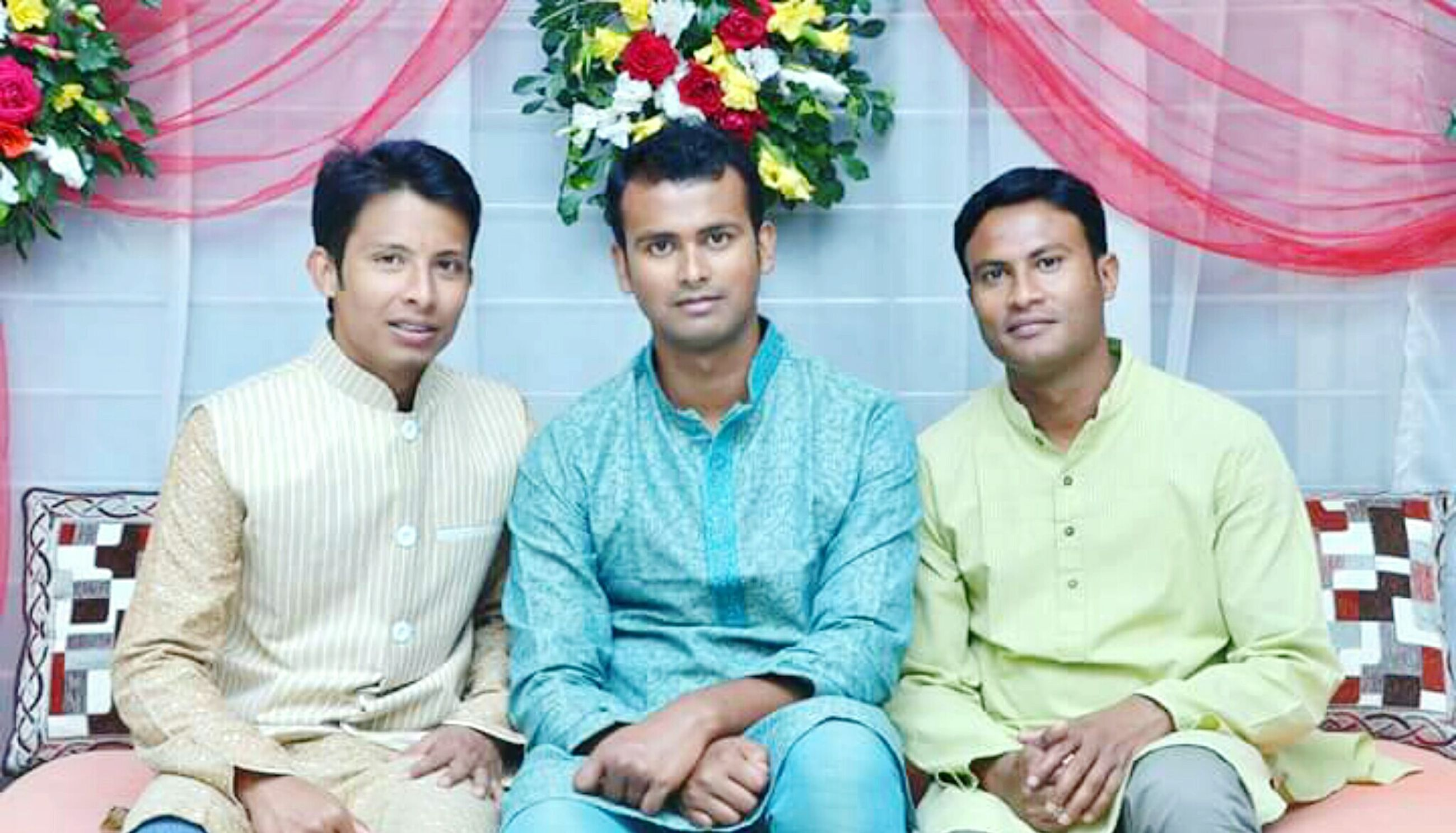 togetherness, bonding, lifestyles, friendship, love, leisure activity, person, casual clothing, portrait, front view, smiling, young men, looking at camera, happiness, family, young adult, sitting