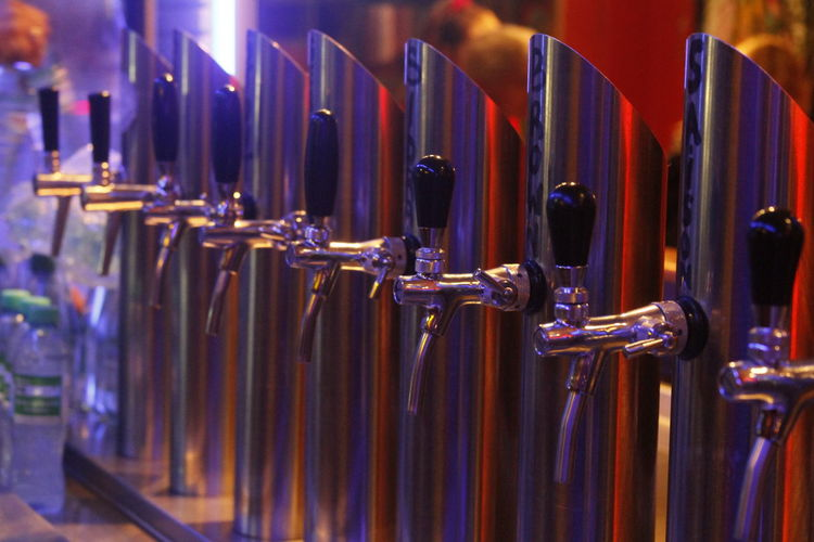 Row of beer taps at microbrewery