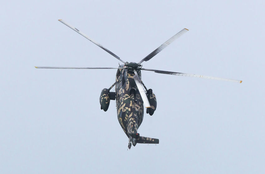 Military helicopters Aerospace Industry Air Vehicle Airplane Army Clear Sky Day Directly Below Flying Government Helicopter Low Angle View Mid-air Military Mode Of Transportation Motion Nature No People on the move Outdoors Plane Propeller Sky Transportation