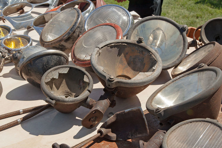 Old Night's Eyes Headlamps Rusty Chrome Glass Repair Sunlight Shadow Day High Angle View No People Large Group Of Objects Metal Outdoors Close-up Still Life Focus On Foreground Antique Sunny Old