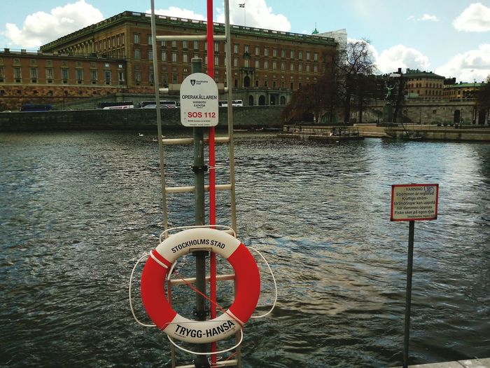 Architecture Outdoors Safety Communication Warning Sign Life Belt Quayside Waterfront Water Royal Palace Stockolm Built Structure Streetphotography Stockholm Sweden Travel Destinations Street Ar