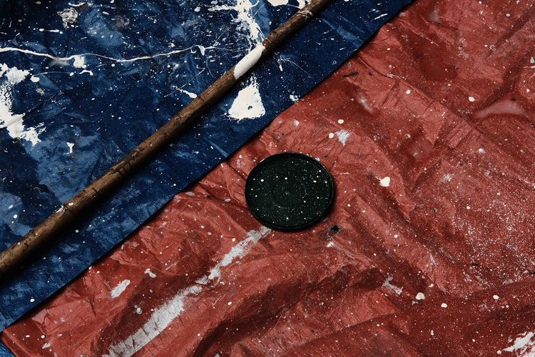 High angle view of splattered paint on tarpaulin