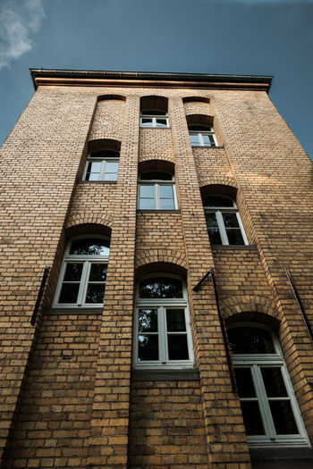 Arch Architecture Brick Brick Wall Building Building Exterior Built Structure City Day Glass - Material Low Angle View Nature No People Old Outdoors Residential District Safety Sky Wall Window