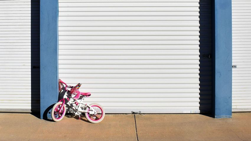 Architecture Bicycle Bike Parke Blue Brown Pin Girls Bike Kids Bike No People Outdoors Pink Bike Storage Transportation