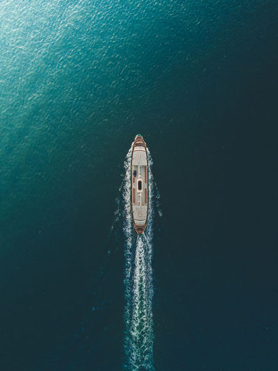 High angle view of boat sailing on sea