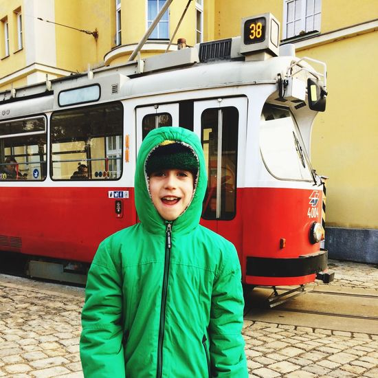 Seven year old boy in front of a tram, Vienna, Austria. Real People Lifestyles Transportation One Person Mode Of Transport Outdoors Leisure Activity Public Transportation Land Vehicle Day Boy tram Travel Austria Travel