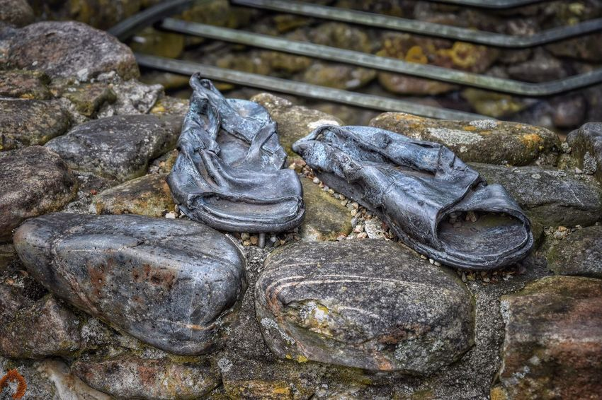 Schoes ArtWork Copper Art Outdoor Art Exhibition Close Up Old Sandals Urban Still Life Streetphotography Stone Wall
