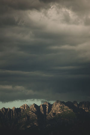 dull skies over mountains top Arid Climate Beauty In Nature Climate Cloud - Sky Environment Formation Landscape Mountain Nature No People Non-urban Scene Outdoors Overcast Rock Rock - Object Rock Formation Scenics - Nature Sky Solid Storm Tranquil Scene Tranquility