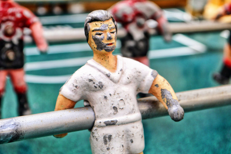 Close-up of statue on foosball