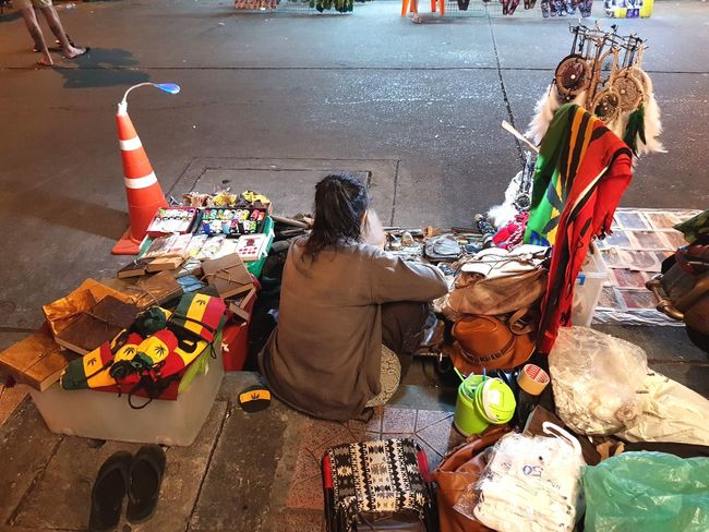 street side shop Real People Life Sideways Shop Street Photography Streetphotography Sitting High Angle View For Sale