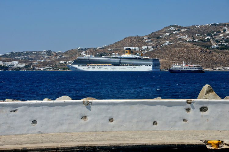 Costa Deliziosa cruise ship moored in the new port of Mykonos. Nautical Vessel Water Sea Transportation Mode Of Transportation Sky Mountain Nature Blue No People Built Structure Ship Day Clear Sky Travel Outdoors Sailing Passenger Craft Cruise Ship Sailboat Yacht Mykonos,Greece Costa Deliziosa Costa Crociere Urban Cruising Cruise Holiday Lifestyles Travel Luxury Landscape