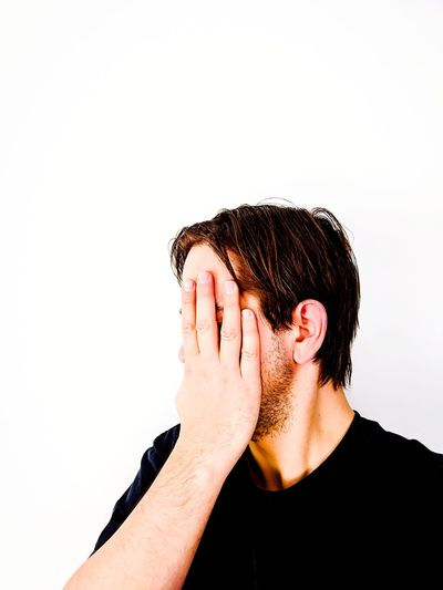 Close-up of man covering face