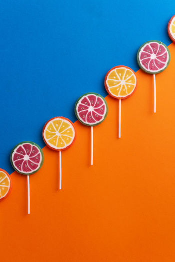 High angle view of cocktail against orange background