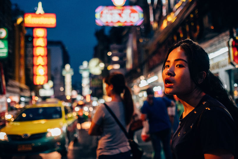 Chinatown Bangkok Architecture Building Exterior Car City City Life City Street Focus On Foreground Illuminated Leisure Activity Lifestyles Neon Night Outdoors People Real People Street Travel Destinations Two People Women Young Adult Young Women