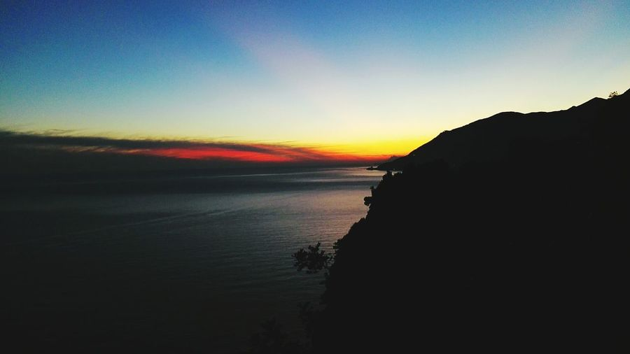 Sunset Silhouette Landscape Scenics Outdoors Travel Destinations Nature Sea Beauty In Nature Mountain No People Sky Tranquility Water Beach Vacations Horizon Over Water Night Astronomy Second Acts EyeEmNewHere Colour Your Horizn