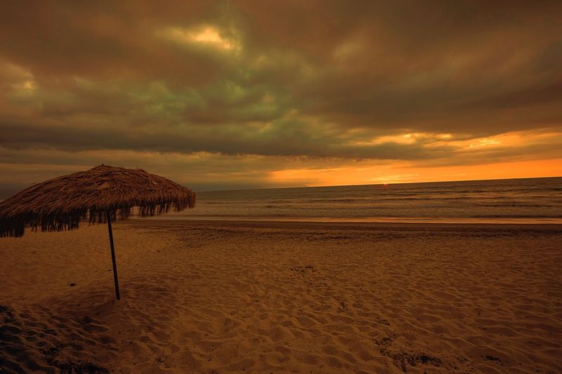 Beach Sunset Nature Sea Sky Beauty In Nature Cloud - Sky Sand Scenics Tranquility Tranquil Scene Shore Horizon Over Water Outdoors Water No People Thatched Roof Day Travel Photography Rickeherbertphotography Vallarta Pvr Been There. Lost In The Landscape