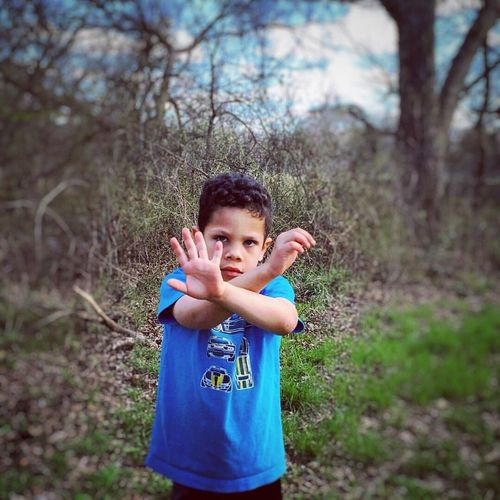Looking At Camera Child Children Only Portrait Childhood Waist Up One Person One Boy Only Tree Standing People Human Body Part Outdoors Nature Day Human Hand Dez Bryant And Me Throw Up The X Pretending 5yrold