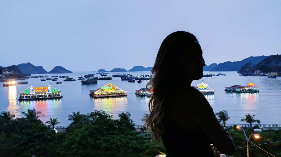 floating restaurants and rock formations Silhouette Livecolorfully Travel Liveoutdoors Aroundtheworld Lifeofadventures Pelomundo Viagens  Light And Shadow Exploremore Balcony View Rockformation Wonderfulworld Ocean Waterfront Island Islandlife Vietnam Vietnam Trip Water Only Women Adults Only One Woman Only Mountain Outdoors Sky One Person One Young Woman Only Beauty In Nature Nature