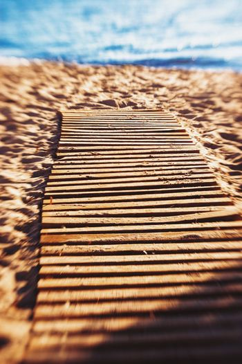 The only way is summer. Water Day Outdoors No People Sea Sunlight Beach Pattern Shadow Sand Nature Tranquility Sky Close-up Horizon Over Water Beauty In Nature Leisure Activity Vacations Seaside_collection Seaside Summer Wood Grain Textured  Sand & Sea
