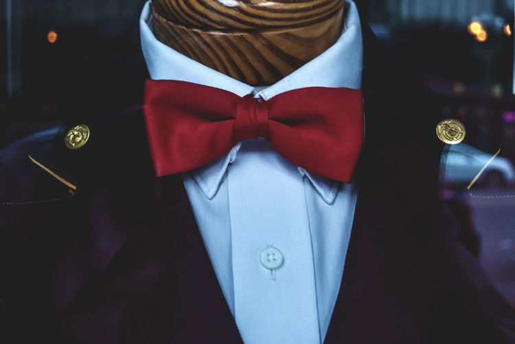 Close-Up Of Red Bow Tie On Mannequin At Store Window