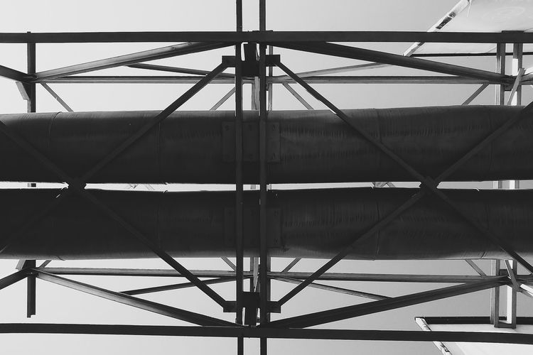 Pipeline over the road Black & White Black And White Black And White Photography Blackandwhite Buiding Built Structure Day Engeneering Engineering Low Angle View Metal Modern Pipe Pipe - Tube Pipeline Steel Structural Structural Engineering Structure Structures & Lines Monochrome Photography