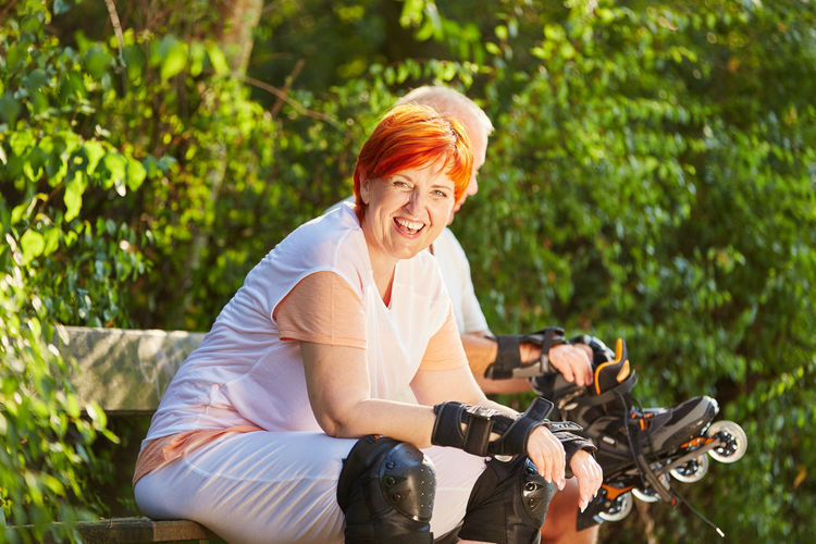 portrait of smiling woman riding bicycle Active Adult Balance Bicycle Casual Clothing Couple Emotion Environment Fitness Forest Hairstyle Happiness Happy Hobby Inline Skates Inline Skating Joy Land Vehicle Leisure Leisure Activity Lifestyles Man Mature Adult Mature Women Mode Of Transportation Movement Nature Old One Person Outdoors Outside People Portrait Real People Ride Riding Rollerblades Rollerblading Roller-skates Senior Senior Citizen  Senior Citizens Seniors Sitting Skater Skates Skating Smiling Sport Start Summer SUPPORT Team Three Quarter Length Together Transportation Vital Woman Women