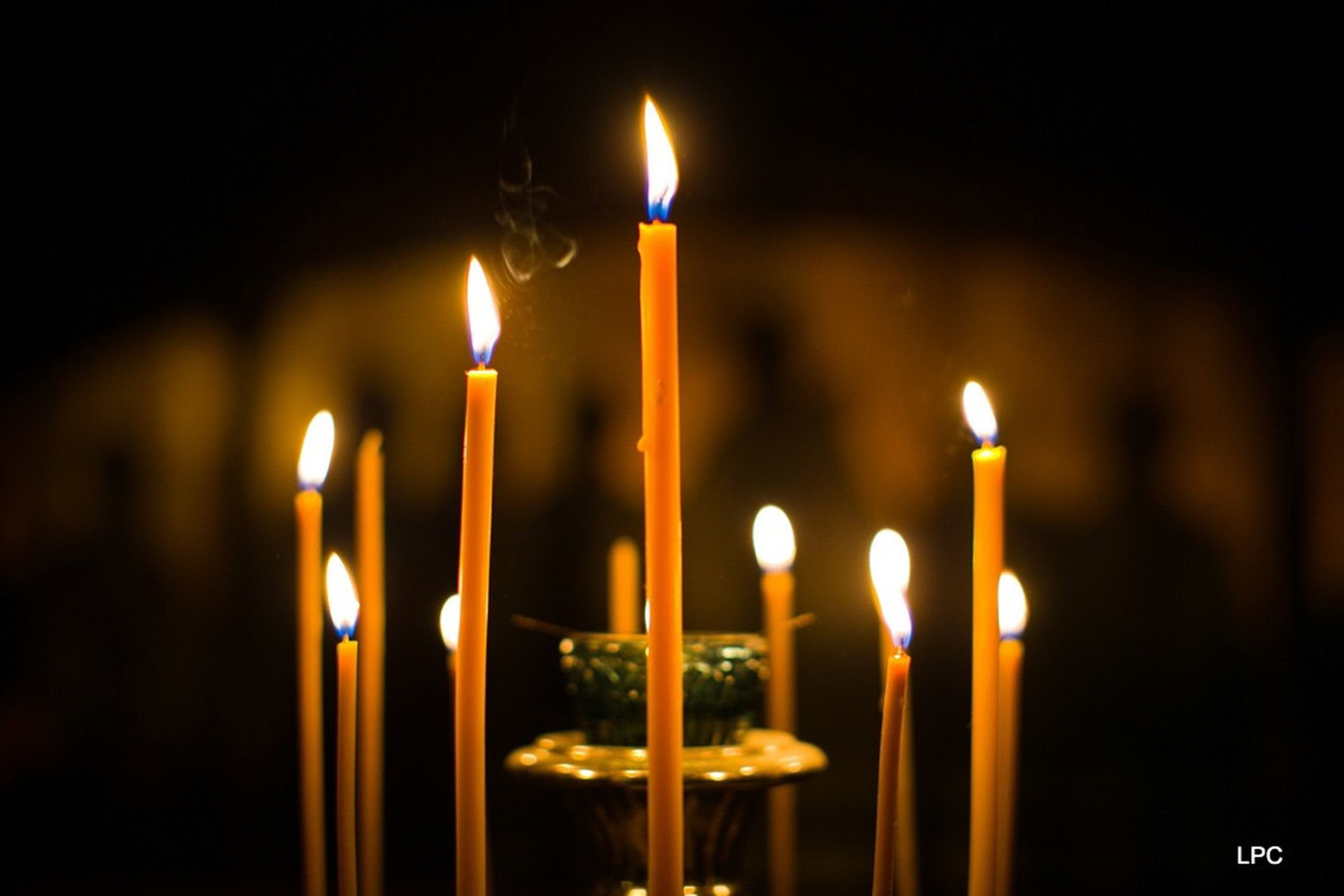 flame, fire, burning, candle, fire - natural phenomenon, heat - temperature, illuminated, close-up, nature, focus on foreground, no people, indoors, glowing, religion, lighting equipment, belief, celebration, spirituality, environment, place of worship, melting, black background