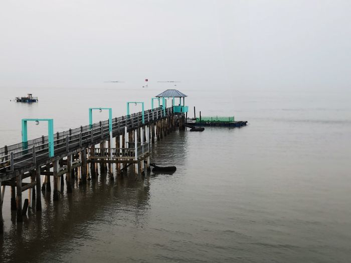 Water Sea Pier Tranquility Tranquil Scene Sky Nature Scenics - Nature Beauty In Nature Day Transportation No People Waterfront Horizon Wood - Material Built Structure Non-urban Scene Horizon Over Water Outdoors Wooden Post