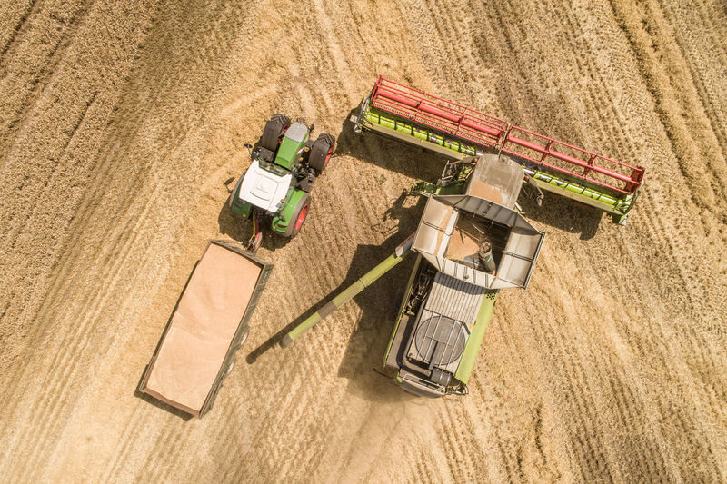 High Angle View Of Agricultural Machinery On Field