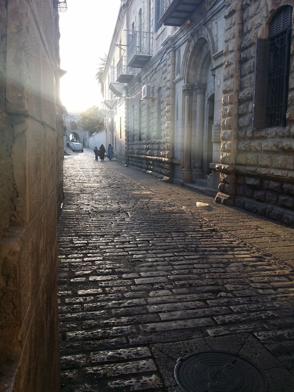 architecture, building exterior, built structure, street, building, city, the way forward, direction, incidental people, cobblestone, day, footpath, residential district, nature, outdoors, history, real people, old, the past, alley, paving stone