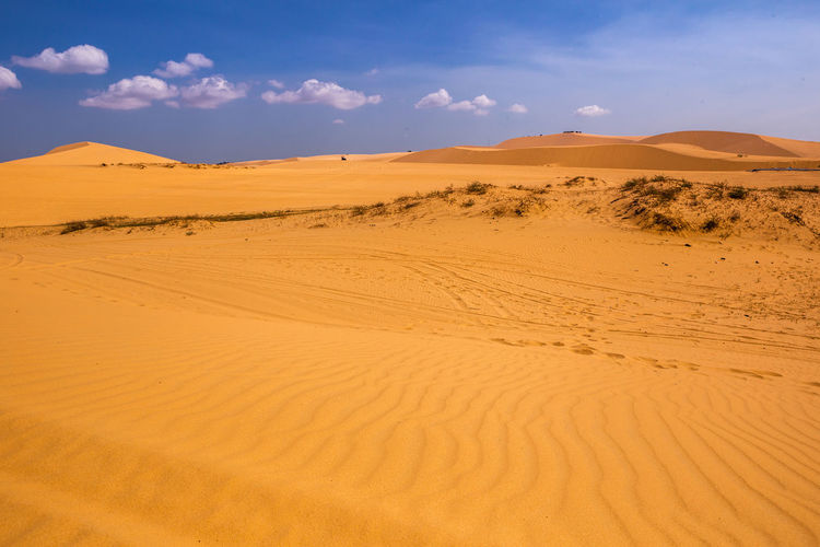 Desert and streaks in Mui Ne, Vietnam Sand Desert Sand Dune Scenics - Nature Land Climate Landscape Sky Arid Climate Tranquil Scene Environment Non-urban Scene Tranquility Beauty In Nature Cloud - Sky Remote No People Nature Horizon Over Land Physical Geography Atmospheric