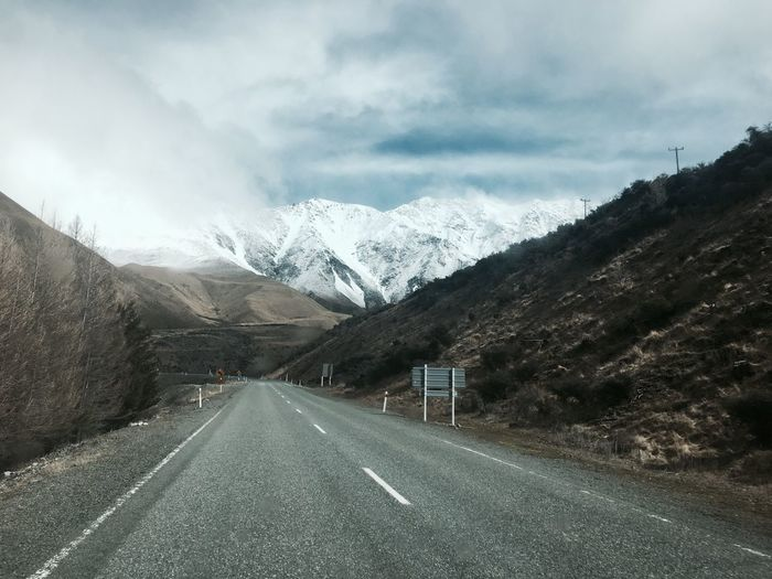 On my way Beautiful Cold Winter Holiday Lifestyles New Zealand Road Transportation Direction Cloud - Sky Mountain The Way Forward Sky Sign Symbol Marking No People Beauty In Nature Snow Diminishing Perspective Day Road Marking Outdoors Nature Mountain Range Scenics - Nature