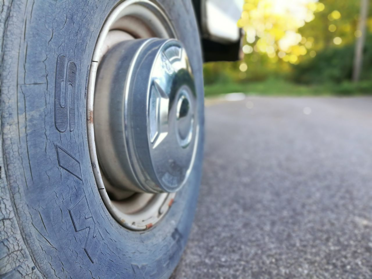 close-up, metal, no people, focus on foreground, day, outdoors, land vehicle