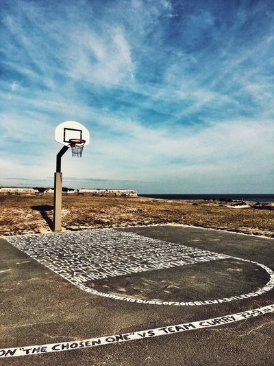 Basketball Sky Sign Cloud - Sky Nature Communication Tranquility No People Horizon Over Water Beauty In Nature Beach Sea Land Outdoors Sunlight Text