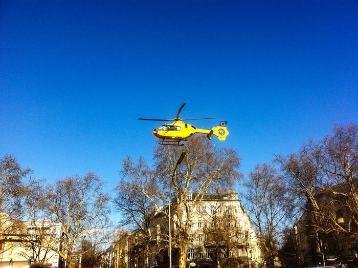 Helicopter flying against blue sky