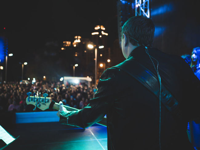 Man Stage Adult Concert Crowd Entertainment Guitar Guitarist Illuminated Indoors  Lifestyles Men Night Nightlife Occupation Occupations People Real People Rear View Syage Technology Wireless Technology