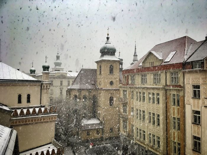 Gentle Snow ... falling in Prague Cityscape EyeEm Best Shots EyeEm Selects Outdoors Snowing City Sky Snow Cold Temperature Window Built Structure Building Exterior