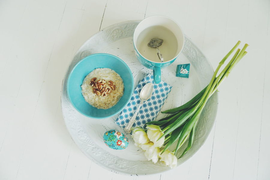 Spring breakfast Blue Bowl Breakfast Day Easter Flower Food And Drink Freshness Healthy Eating High Angle View Indoors  No People Oatmeal Porridge Spring Spring Flowers Tea Tea Time Tulip Tulips White Background