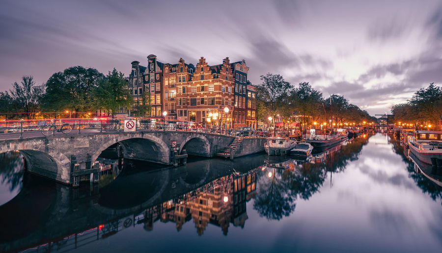 Amsterdam Boats Bridge Building Exterior Canal City City Life Cloud - Sky Dusk Illuminated Long Exposure Night Lights Old House Perfect Reflection Prinsengracht Reflection Residential District Sky Standing Water Water Waterfront