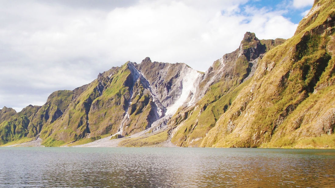 Mount Pinatubo Crater Lake Philippines Travel Wanderlust Beauty In Nature Cloud - Sky Crater Day Explore Lake Landscape Mountain Mountain Range Nature No People Outdoors Scenery Scenics Sky Tranquil Scene Tranquility Volcanic Landscape Volcano Water Waterfront