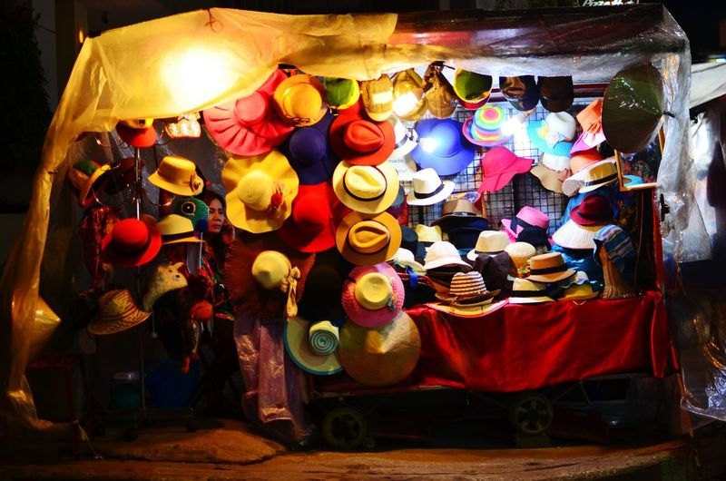 A woman selling hats at the night market in Chiang Mai Hats Night Market Chiang Mai Thailand