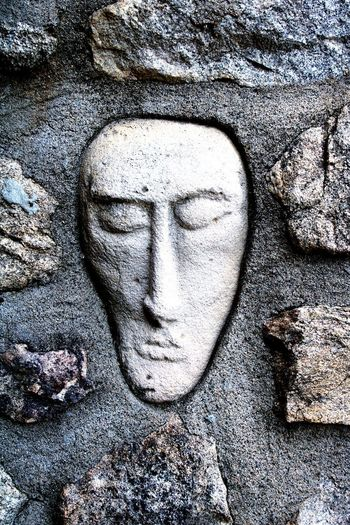Close-up of human face against wall