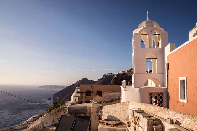 Architecture Bay Beautiful Nature Building Exterior Coastline Crossofchrist Day EyeEm Best Shots EyeEm Nature Lover Fira Santorini Greece Houses Mediterranean  No People Outdoors Place Of Worship Religion Romantic Santorini Sky Sunset Travelblogger Worldnomads